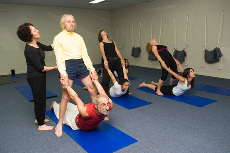Work as team to stretch the back