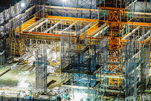 construction-site-with-concrete-slab-steel-wire-mesh-and-rebar-rods-large-yellow-crane-and-yellow-concrete-formwork-shoring