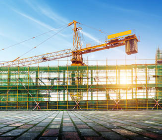 large-bridge-construction-site-with-scaffolding-and-green-safety-nets-and-large-yellow-crane