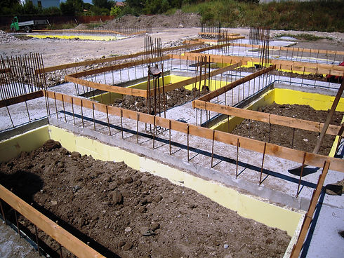 infrastructure-foundation-work-rebar-concrete-slabs-with-yellow-composite-earth-shoring-concrete-formwork-composite-panels
