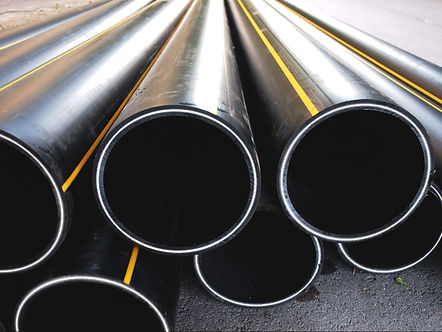 pile-of-large-black-high-pressure-multilayered-reinforced-composite-pipes-ready-to-be-laid-in-highly-corrosive-infrastructure