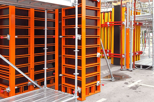 construction-site-with-concrete-formwork-system-of-orange-metal-beams-braces-with-durable-black-reinforced-composite-boards