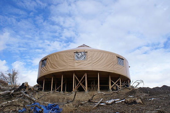 nomad shelter alaskan 40 foot yurt with tan cover under open sky