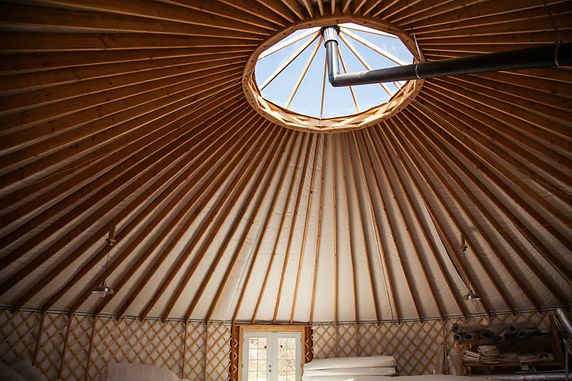 nomad shelter alaskan yurt rafters with skylight and stovepipe