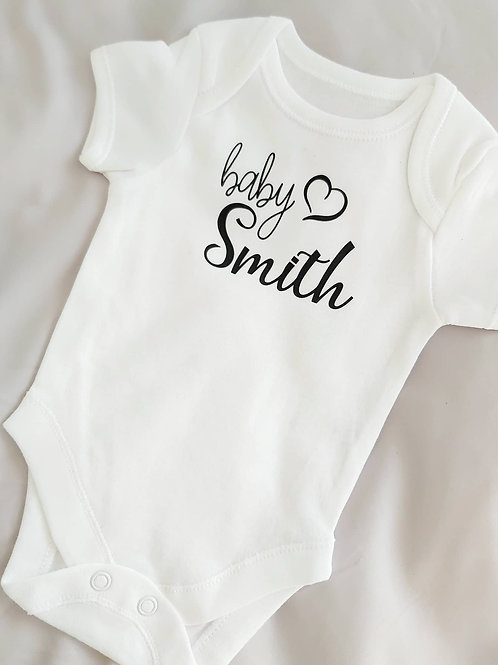 PREGNANCY/BIRTH ANNOUNCEMENT VEST/SLEEPSUIT WITH HEART