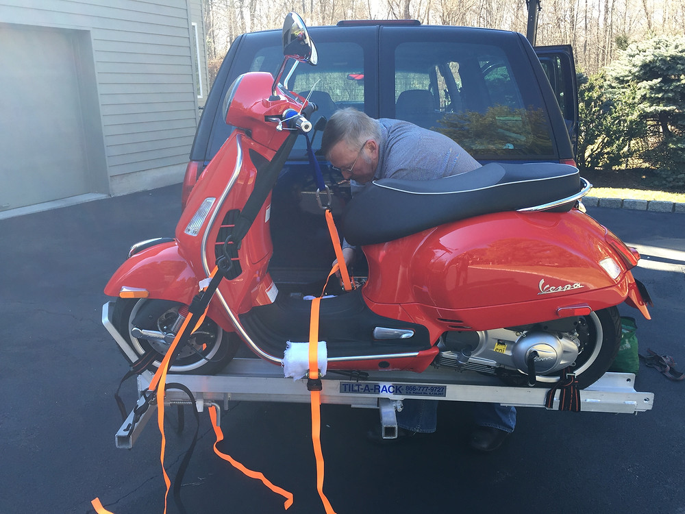 Bob helping to strap on Scott's new scoot on the carrier.