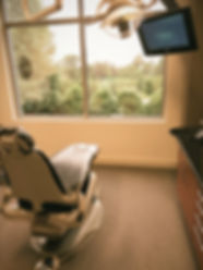 Don Harvey Dental's relaxing patient rooms with a view include comfort menu items such as warm blankets, massage chairs, soothing eye masks with music and more.