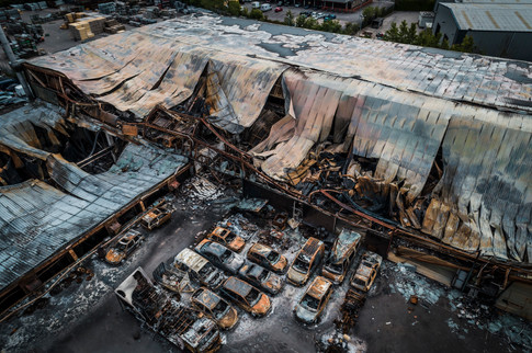 Burnt out commercial building survey