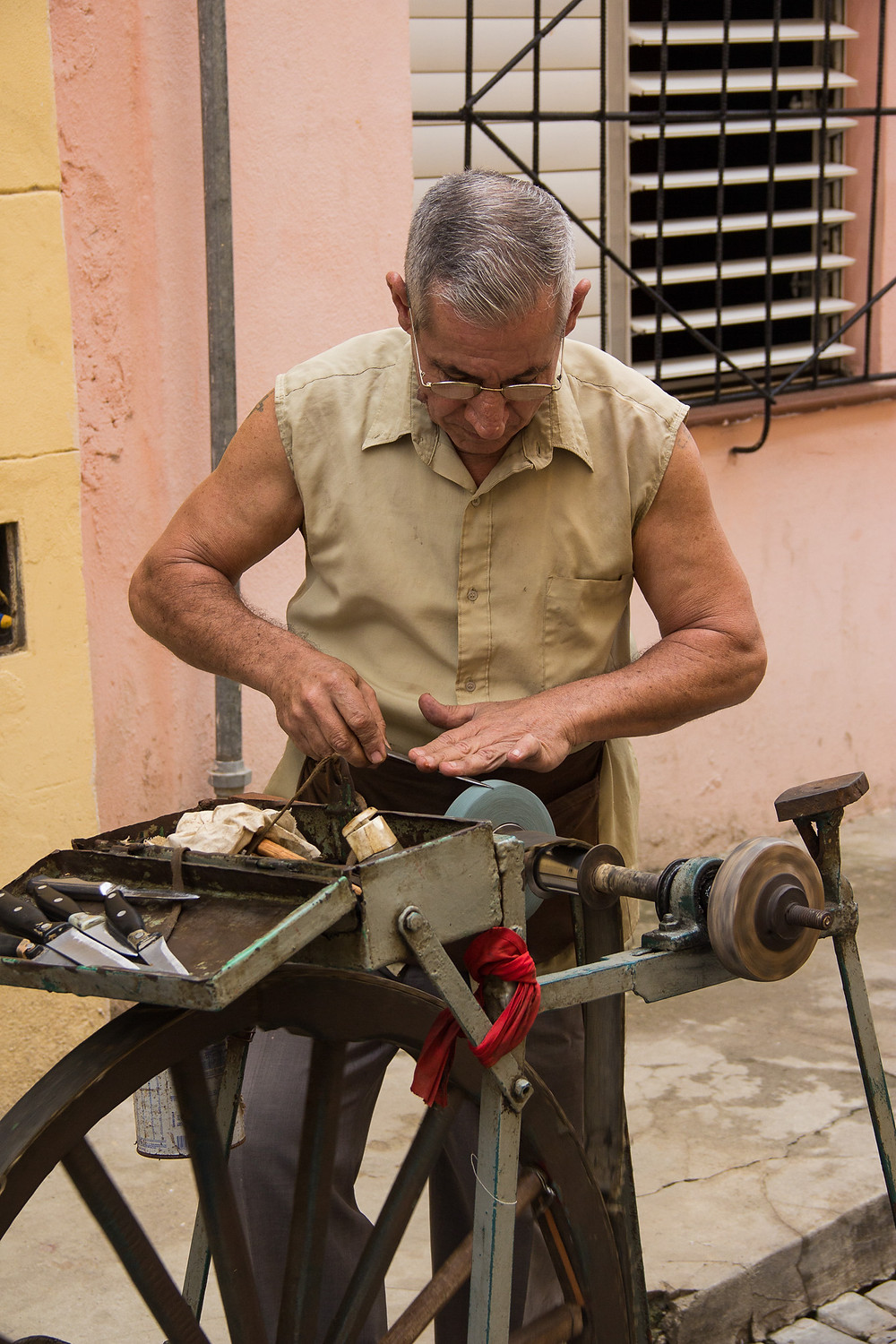 A knife sharpener working in the streets