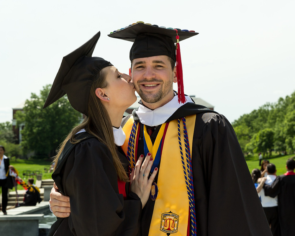 graduation umd couple kiss