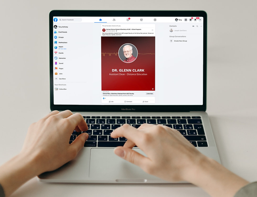 Image of hands in front of a laptop visiting USC Ostrow's Facebook page.