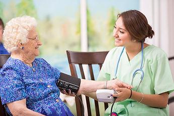 iStock-Home+healthcare+nurse+checks+bloo