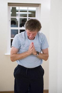 Man finishing a yoga class