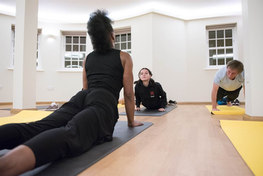 stretching core and spine in a yoga class