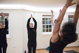 reaching back in a yoga class