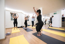 striking a pose in a yoga class