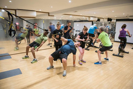 mixed exercise class wth mirror