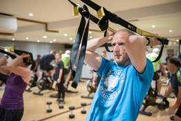 Man pulling on exercise class ropes