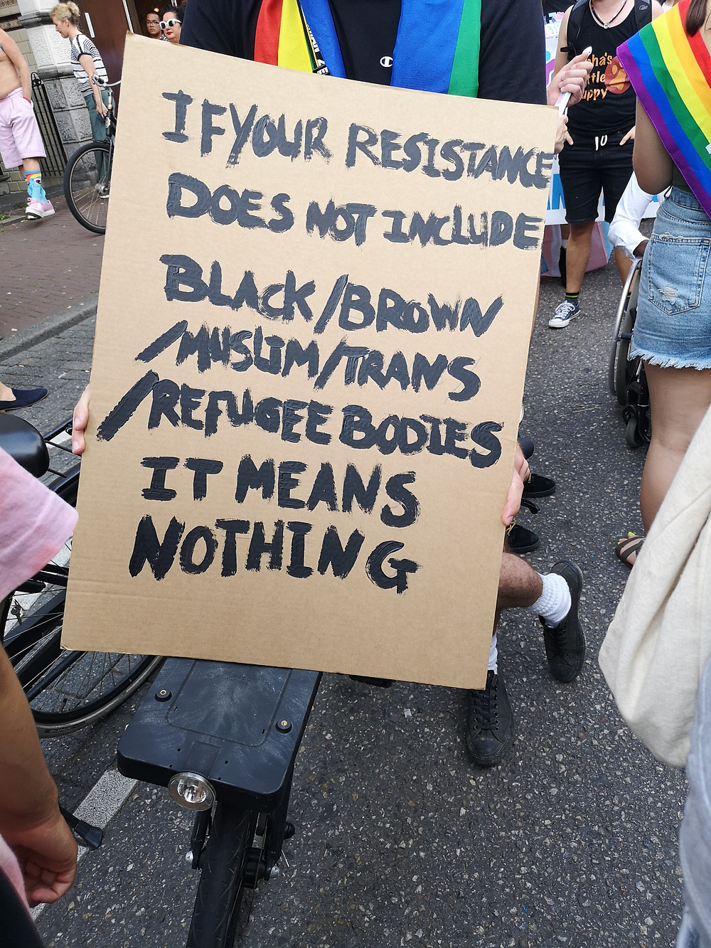 "Picture of a poster at a protest that reads ""if your resistance does not include Black / Brown / muslim / trans / refugee bodies it means nothing"