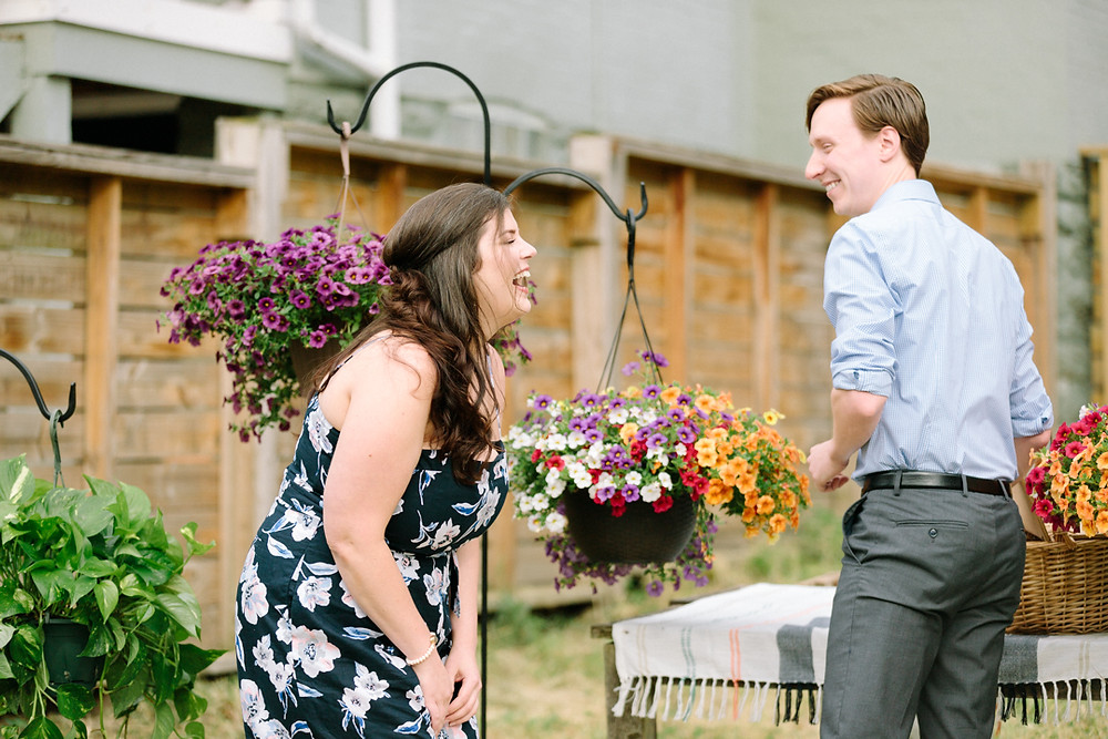 Surprise proposal in Pittsburgh, Pa with woman and man laughing.