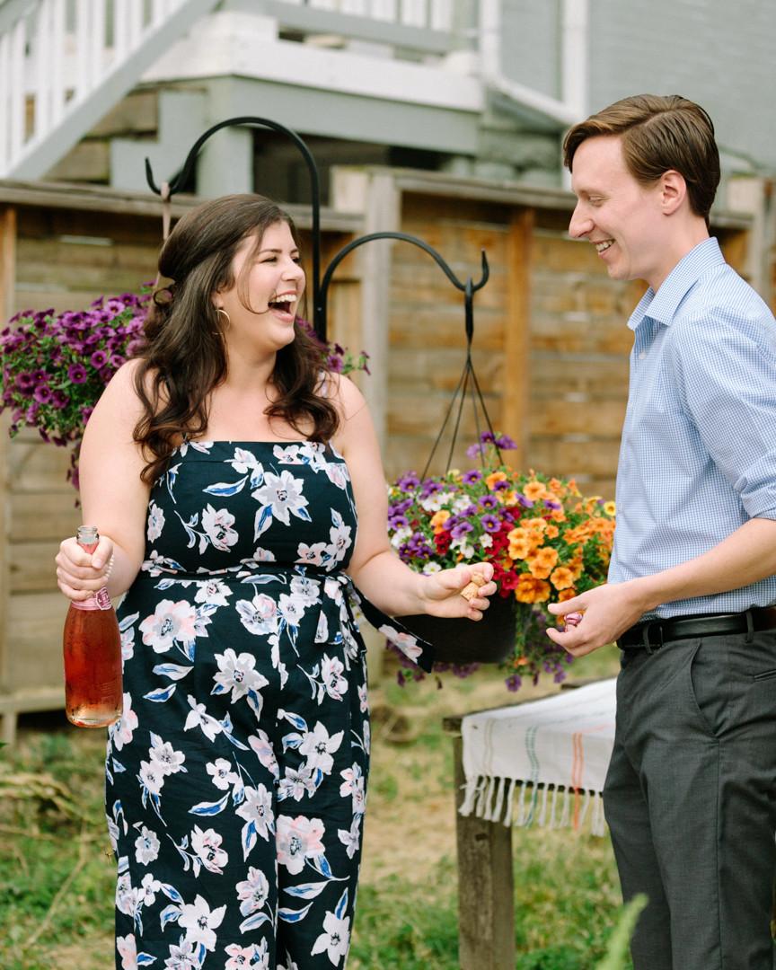 Champagne bottle popped, couple celebrating engagement!