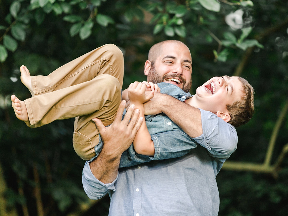 Candid family photo of a father and his son by LeeAnn Stromyer.