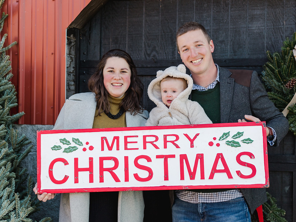 Family photo in front of barn door at Nutbrown's Tree Farm in Pittsburgh, PA