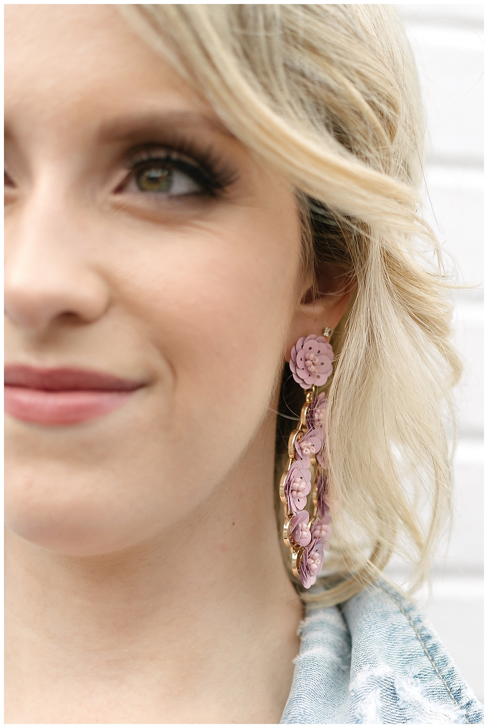 Detail shot of a floral pink earring. Photo by LeeAnn K Photography Styled by Meredith of The Look