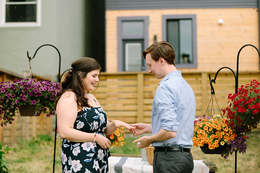 Surprise proposal, couple looking down at ring in Pittsburgh Pa by LeeAnn K Photography.