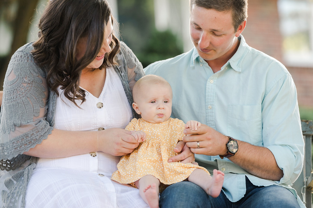 Lifestyle family portrait with a baby and her parent by LeeAnn K Photography