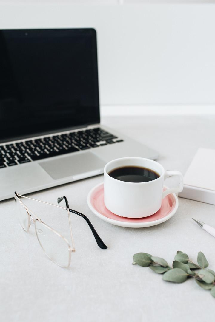 Image of a coffee mug and computer.