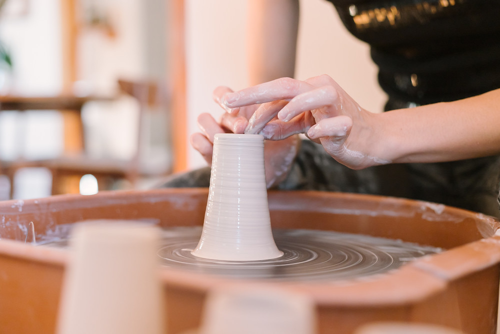 Throwing on the wheel, ceramic artist, personal brand photography by LeeAnn K Photography.