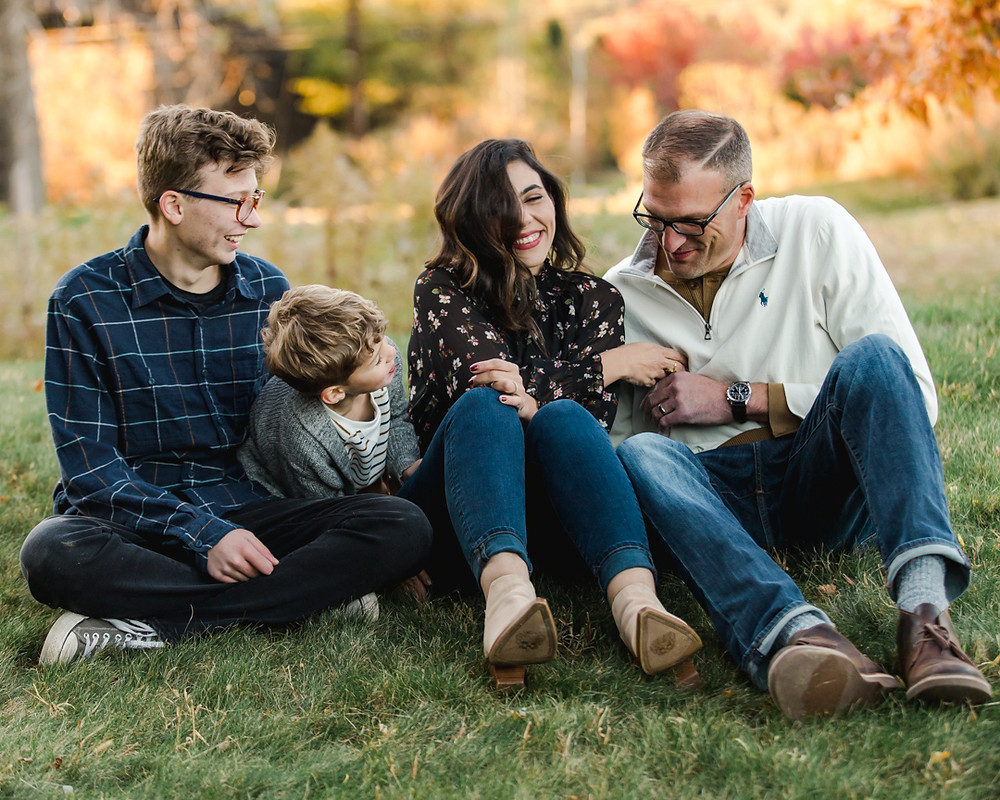 Fall Family photo of four in a park having a tickle fight in Pittsburgh, pa by LeeAnn K Photography
