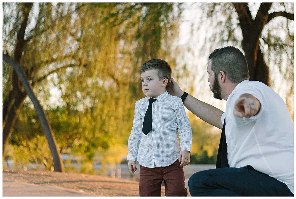 Portrait of a toddler and his dad trying to get his son to look at the camera in Phoenix, AZ. Pittsburgh Family Photographer- Photo by LeeAnn K Photography