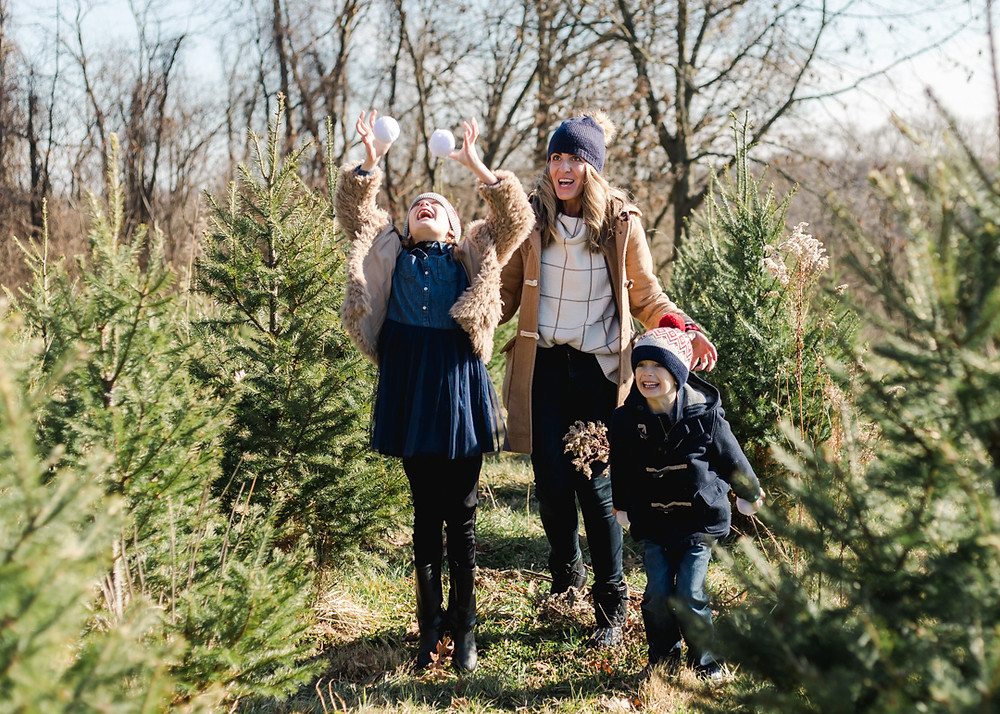 Holiday family photo with Christmas trees by LeeAnn Stromyer