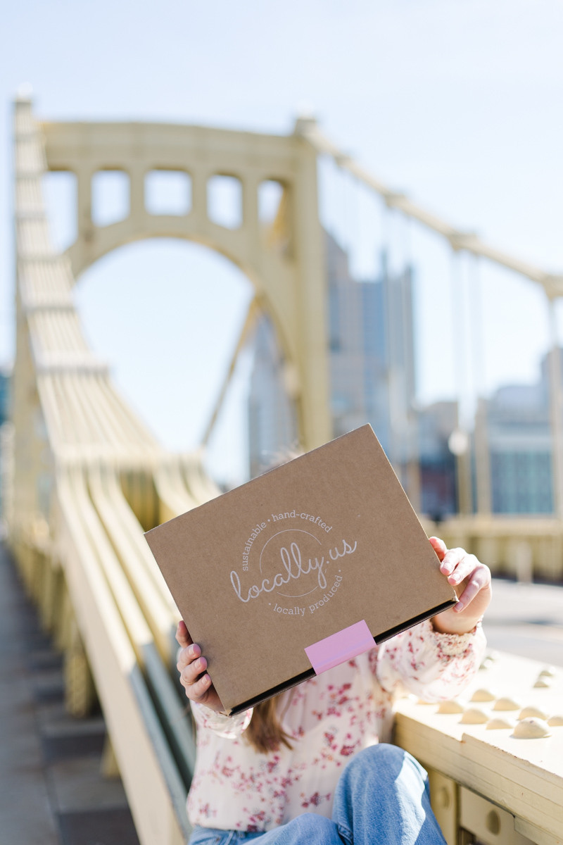 Brand shoot on Pittsburgh's Clemente bridge for locally us a curated box of locally sourced good created by female owned businesses.