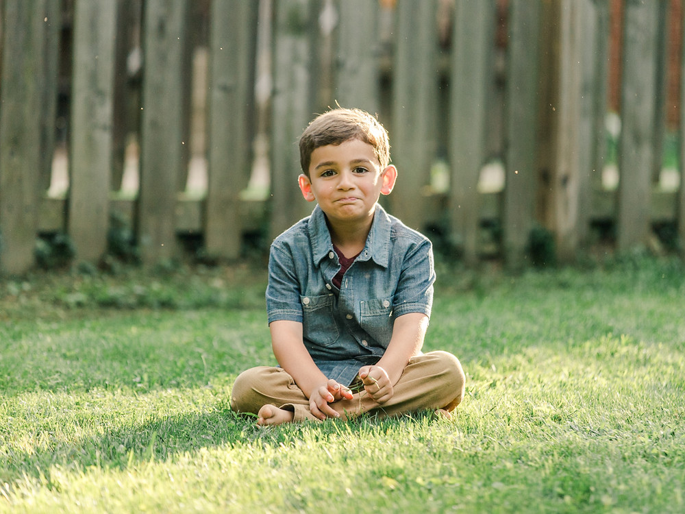 Candid portrait of a five year-old boy in his back yard by LeeAnn K Photography