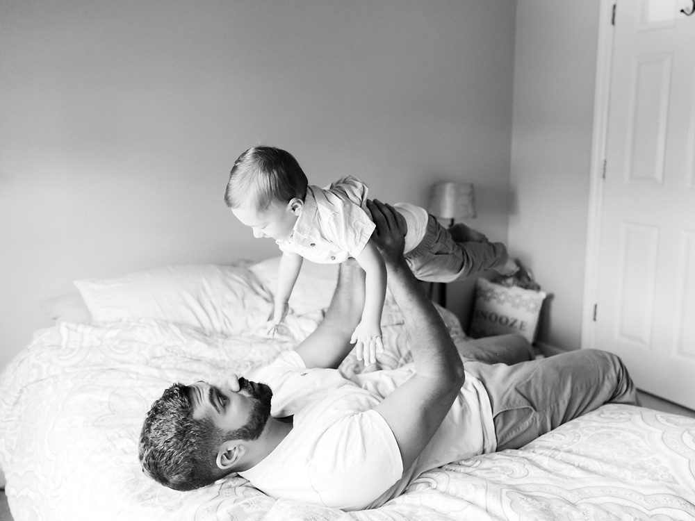 Family photo of a son and his dad in their home by Pittsburgh family photographer LeeAnn Stromyer