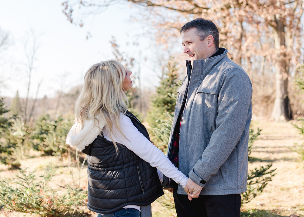 Husband and wife holiday photo at Nutbrown's tree farm by LeeAnn K Photography