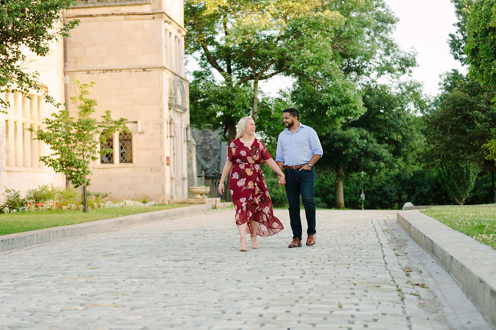 Hartwood Acres Mansion in the background of an engaged couple.
