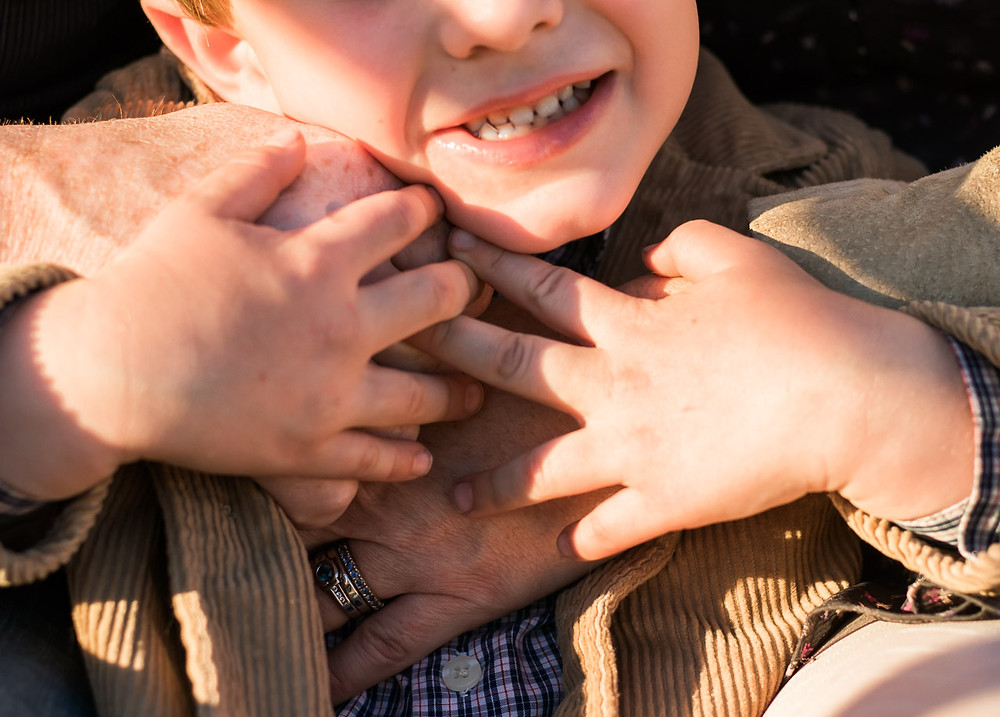Close up of a father, mother and son's hands by LeeAnn K Photography, Pittsburgh Pa & Phoenix Az