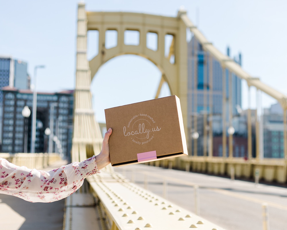Brand shoot on Pittsburgh's Clemente bridge for locally us a curated box of locally sourced good created by female owned businesses taken by LeeAnn K Photography.