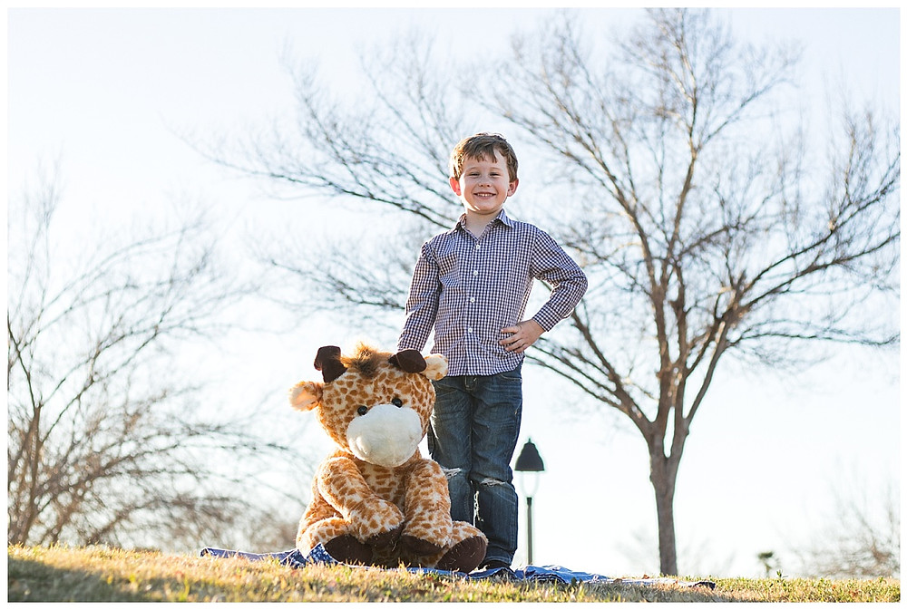 5 year portrait of this cool kid with his childhood toy he has been taking a picture with his whole life. Family photography by LeeAnn K Photography.