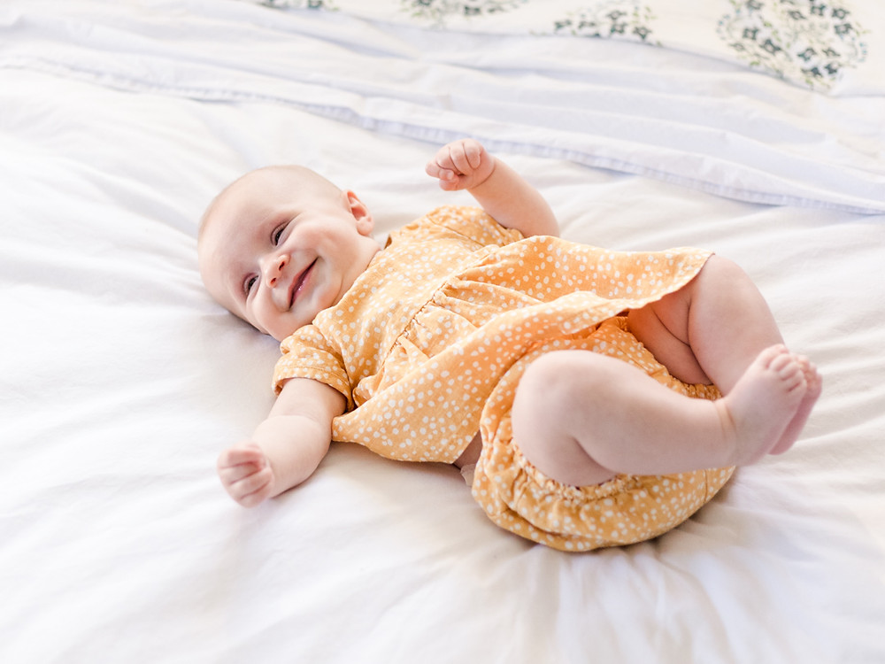 Candid baby portrait  for an in-home family session by LeeAnn K Photography