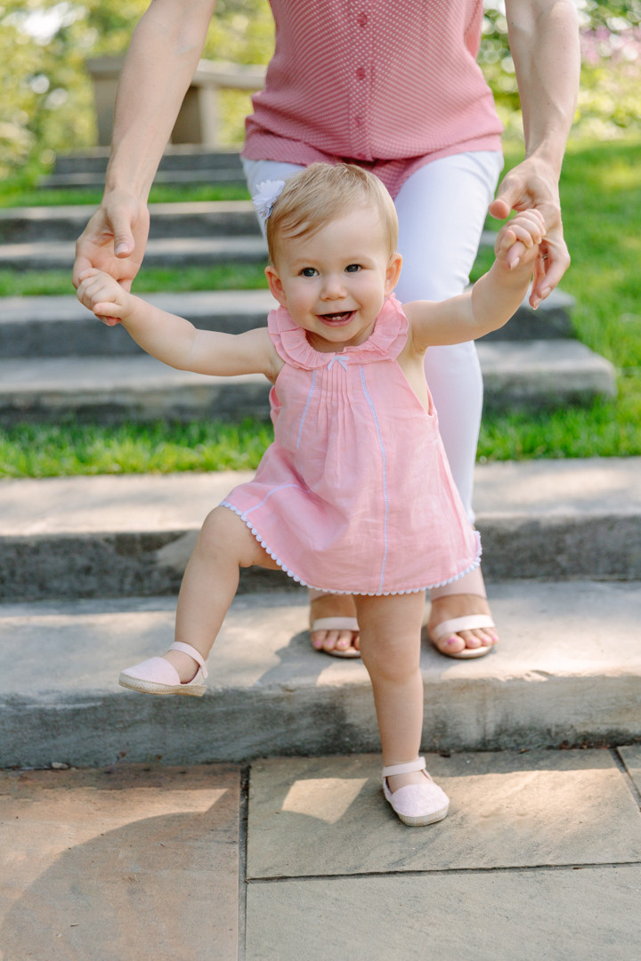 portrait of a toddler and her mom holding her hands in Mellon Garden, by LeeAnn K Photography