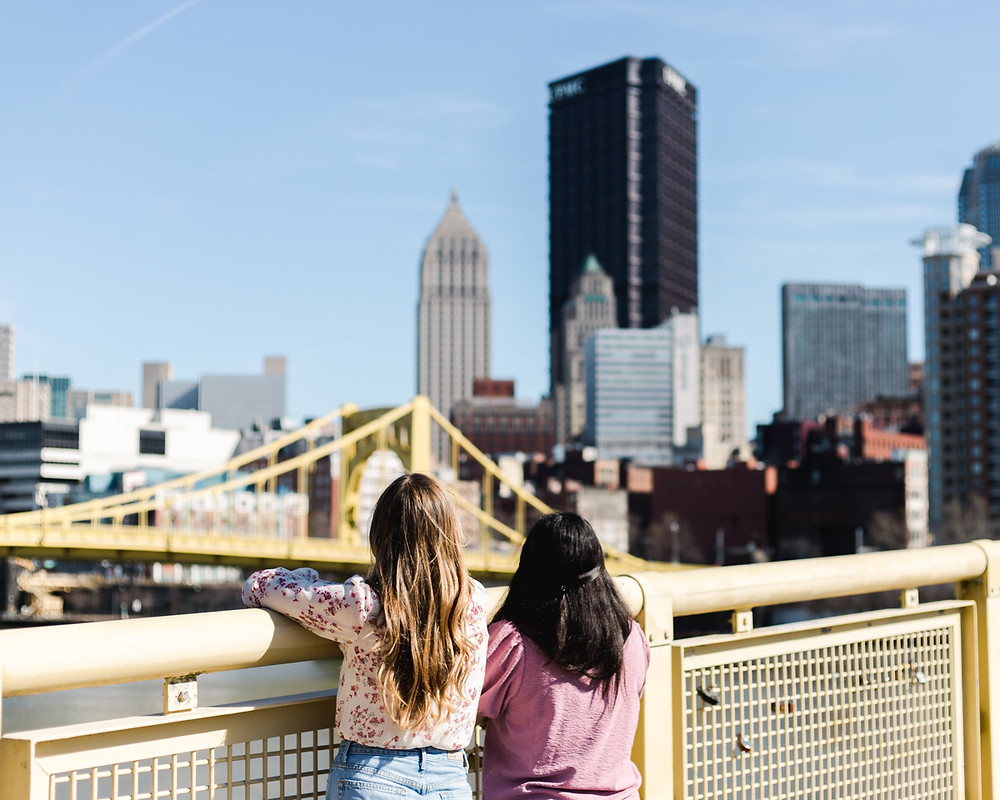 Personal brand shoot for Owners of Locally.Us on the Clemente bridge overlooking Pittsburgh.