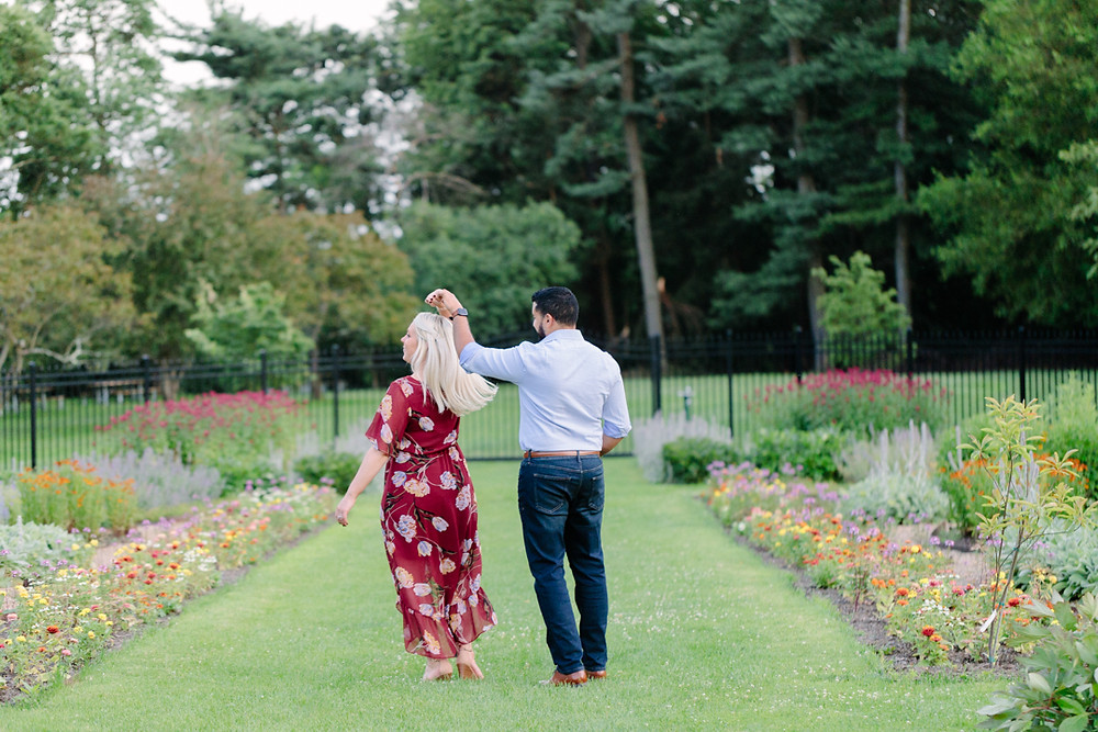 Engagement photo at Hartwood Acres, dancing in the flower garden by LeeAnn K Photography