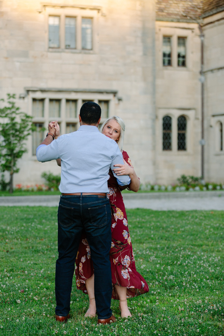 Slow dancing in front of Hartwood Acres Mansion, Allison park, PA. Engagement photo by LeeAnn Stromyer