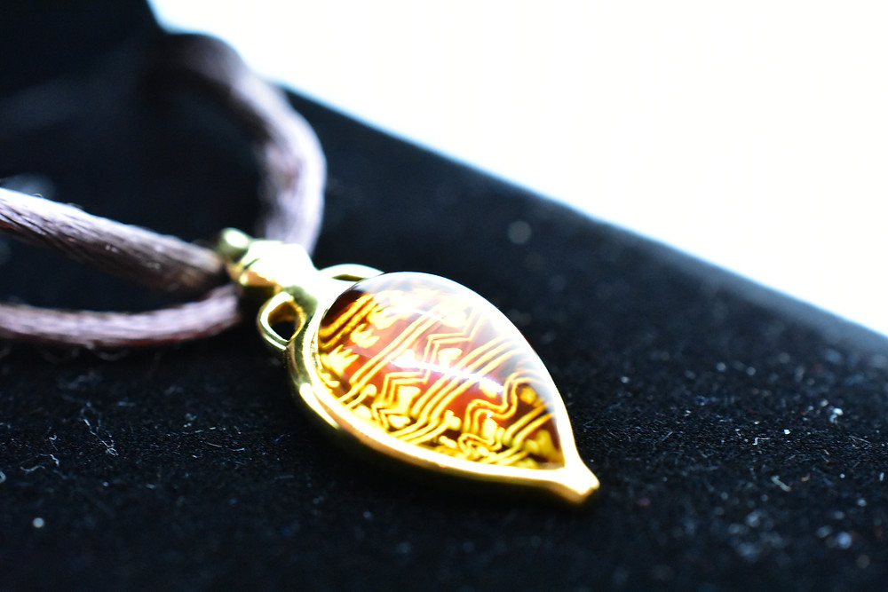 Hand Engraved Amber Pendant, with 18 K Gold-Plated 925 Sterling Silver
