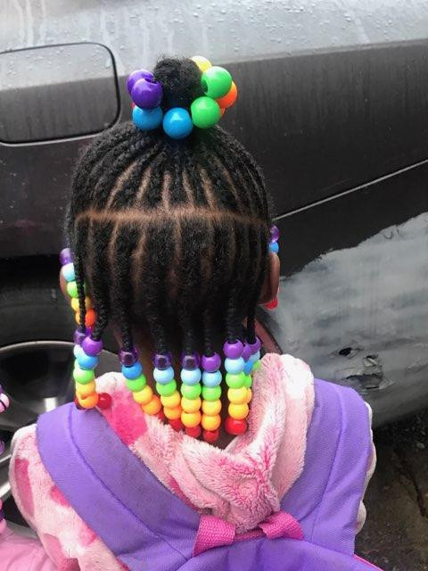 black little girl with colorful beads